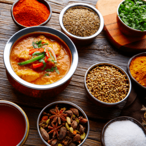 A variety of Indian cuisine dishes including rice, colorful sauces and soups, which pair well with cannabis terpenes like eugenol.