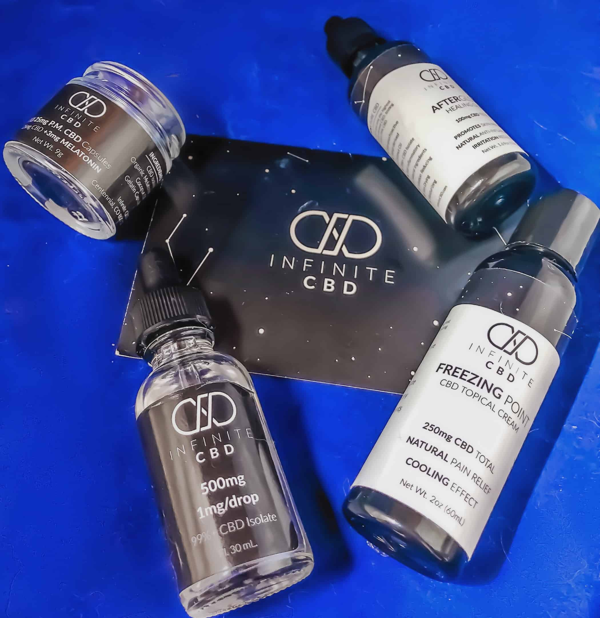 Infinite CBD products against a blue backdrop.