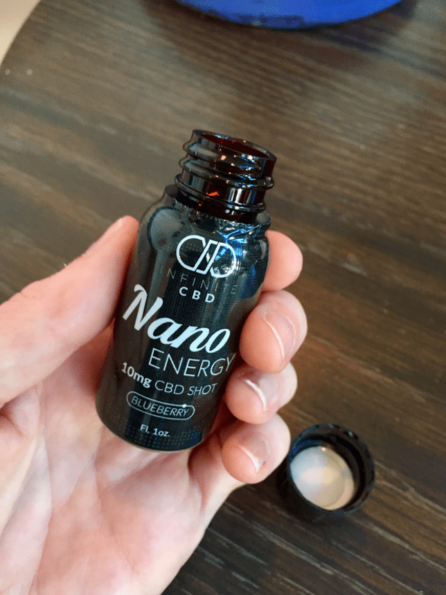 Infinite CBD Review - Nano Energy Shot - Hands - Save On Cannabis