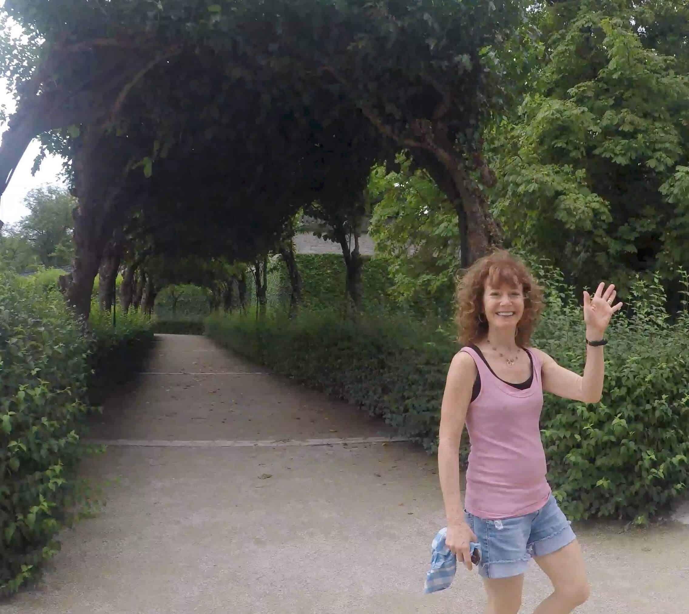 Rena waving handing while walking